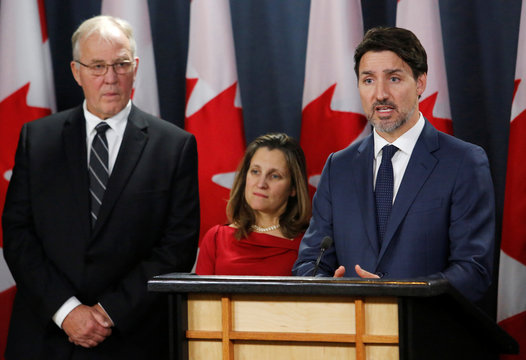 Canada's Prime Minister Justin Trudeau speaks to news media along with Minister of Public Safety and Emergency Preparedness Bill Blair, and Deputy Prime Minister Chrystia Freeland in Ottawa