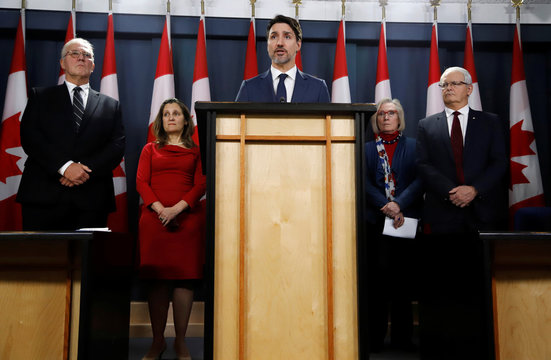 Canada's Prime Minister Trudeau speaks to news media along with cabinet members, left to right, Minister of Public Safety and Emergency Preparedness Blair, Deputy Prime Minister Freeland, Minister of Crown-Indigenous Relations Carolyn Bennett, and Minister