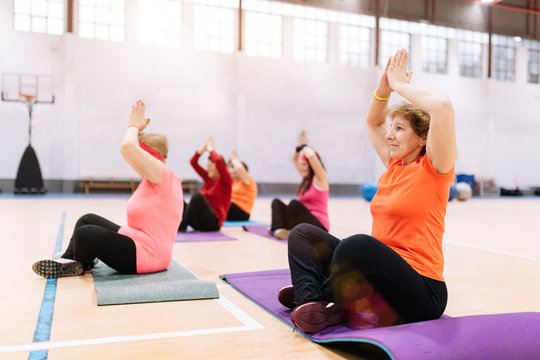 older women doing gymnastics and yoga in the ward with coach