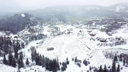 Wall Mural - Aerial view of rural mountain community in the Winter.