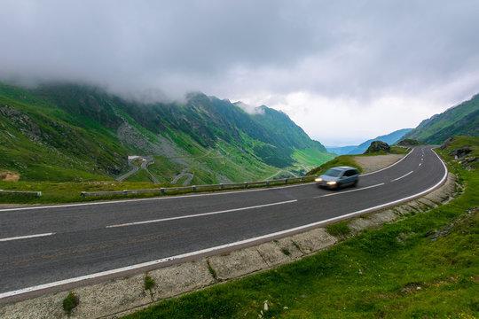 alpine road through mountain valley. epic view of transfagarasan route. popular travel destination. gorgeous landscape of fagaras mountains, romania. cloudy weather