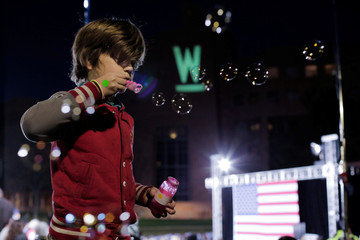 Jasper Jaynes, 8, blows bubbles while waiting with parents for a town hall event with U.S. Democratic presidential candidate Senator Elizabeth Warren and former presidential candidate Julian Castro at the Clark County Government Center Amphitheater in Las