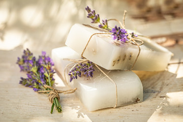 Obraz Natural cubes of lavender soap on white chair - fototapety do salonu