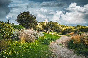 Wall Mural - Dramatic sky above the lighthouse. Location cape Milazzo, Sicily, Italy, Europe.