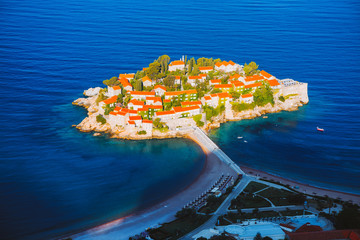 Fototapete - Aerial view of the small islet Sveti Stefan. Location Montenegro, Adriatic sea, Europe.