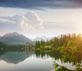 Wall Mural - Calm mountain lake in National Park High Tatra. Location place Strbske pleso, Slovakia, Europe.