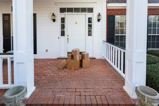 Packages on front porch of home