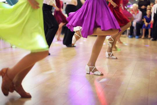Children's legs in a ballroom dancing shoes ready to dance competition