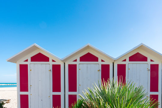 pink beach cabins on the beach of Fano, Italy