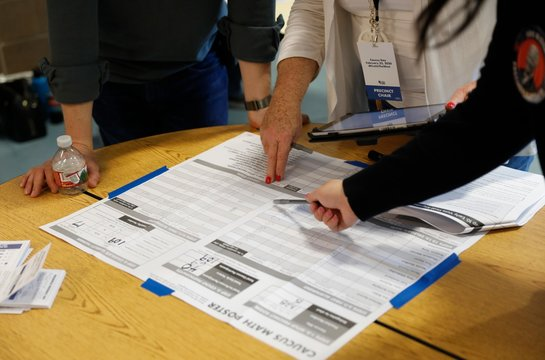 Nevada Caucus workers tally votes and report them to the Nevada Democratic Party through an Ipad in Henderson, Nevada