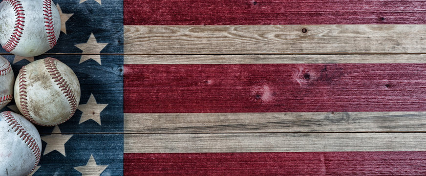 Old baseballs on vintage wooden USA Flag background with copy space