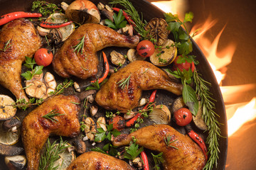 Fototapete - Top view of grilled chicken thigh with various vegetables on pan on the flaming grill ..