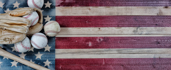 Old baseball objects on United States vintage wooden flag background. Baseball sports concept with copy space