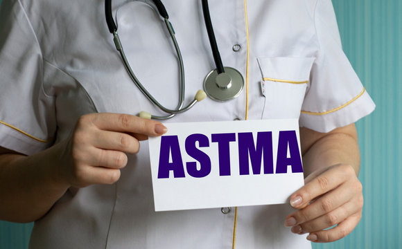 concept words astma in the hands of a doctor