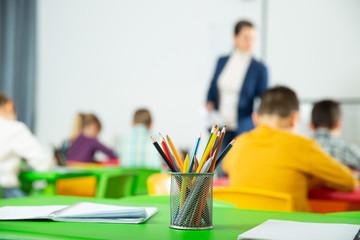 Colored lead pencils on pupils desk