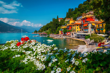 Wall Mural - Varenna resort view with anchored boats in harbor, lake Como