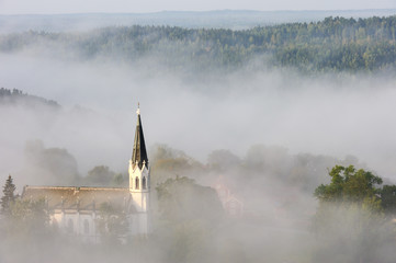 Foto op Canvas Bleke violet Church tucked into fog, Sweden.