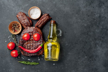 Grilled Easter steak with spices. Easter bunny on stone background with copy space for your text.