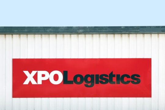 Fontanil, France - June 16, 2019: XPO logistics warehouse. XPO logistics is one of the 10 largest providers of transportation and logistics services in the world and It operates in 32 countries