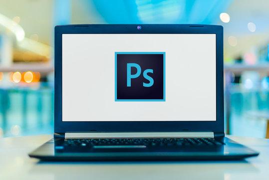 Laptop computer displaying logo of Adobe Photoshop