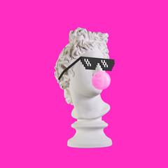 Statue on a pink background. Gypsum statue of Apollo head. Man. Creative. Plaster statue of Apollo...