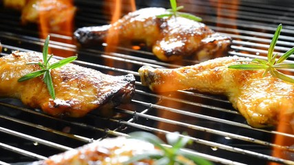 Wall Mural - Grilled chicken on the flaming grill .