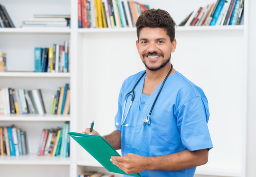 Handsome latin american doctor with beard