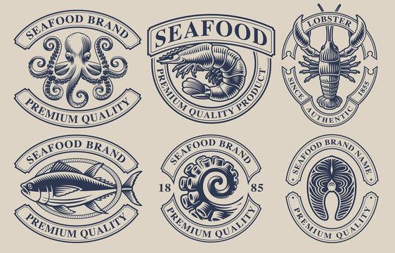 Set of vintage badges for seafood theme.