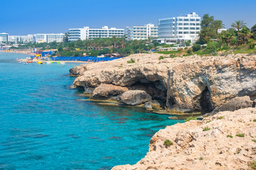 Cyprus. Ayia Napa panorama. Hotels on the Cyprus shore. The Mediterranean sea mountainous coast. Blue lagoon. Resort cities of Mediterranean. The tourist beaches in Cyprus.