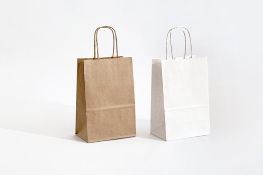 brown and white eco paper bag