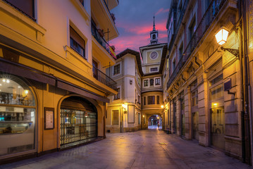 Oviedo, Spain. Clock Tower of Town Hall at dusk Fototapete