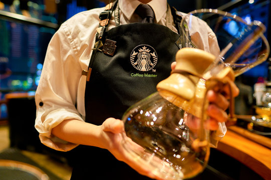 SHENZHEN, CHINA - CIRCA FEBRUARY,  2019: barista show Chemex coffeemaker at Starbucks Reserve in Shenzhen. The Chemex is a manual pour-over style glass coffeemaker.
