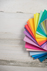 Colorful stack of sample swatches for paint or fabric in spectrum rainbow colors