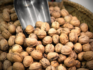 bulk of walnuts and and a grocery shovel