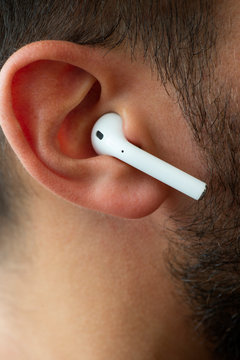 One of the airpods on an ear.