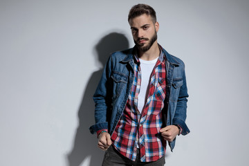 Handsome fashion model adjusting his jacket Wall mural
