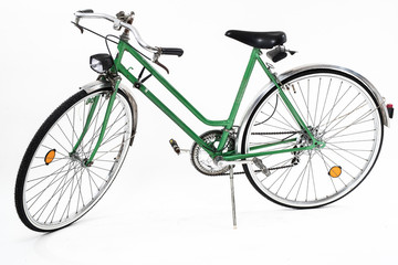 Photo sur Toile Velo An old retro looking green vintage city bicycle for women, isolated o white background. Side view