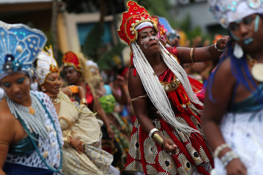 Women dance during the afro female block Ilu Oba de Min in Sao Paulo