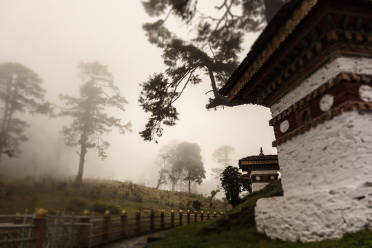 Druk Wangyal, Bhutan, 108 chorten or stupas, a memorial in honor of the Bhutanese soldiers at the Dochula Pass on a cloudy foggy day in altitude of 3000 meters. A bhutanese sanctuary