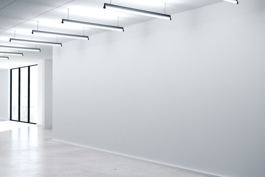 Modern office interior with empty concrete wall
