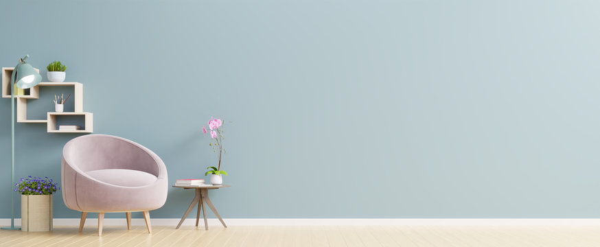 The interior has a pink armchair on empty blue wall background.