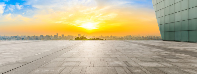 Wide square floor and city skyline at sunrise in Hangzhou,China.