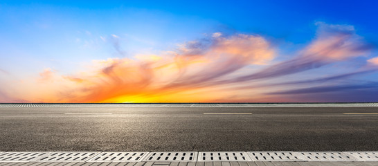 Empty asphalt road and beautiful colorful clouds landscape at sunset,panoramic view. Fotomurales