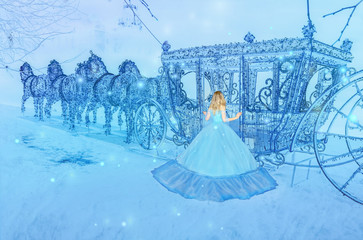 Beautiful princess in blue long dress on the luminous blue carriage background. Art processing.