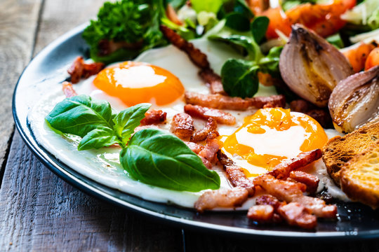 Continental breakfast - sunny side up eggs ,toasts and vegetable salad