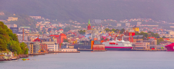 Fototapeta Bergen, Norway city banner view from the sea with harbor, church tower and colorful traditional houses