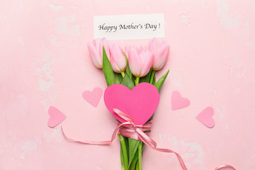Beautiful flowers and card for Mother's Day on color background