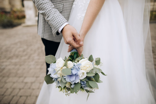 Love, wedding concept. Bride and groom holding hands