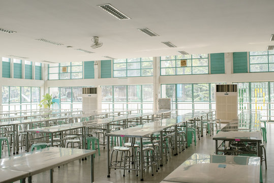 Clean school cafeteria with many empty seats and tables in Bangkok Thailand.