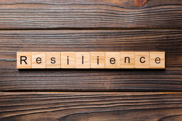 resilience word written on wood block. resilience text on table, concept